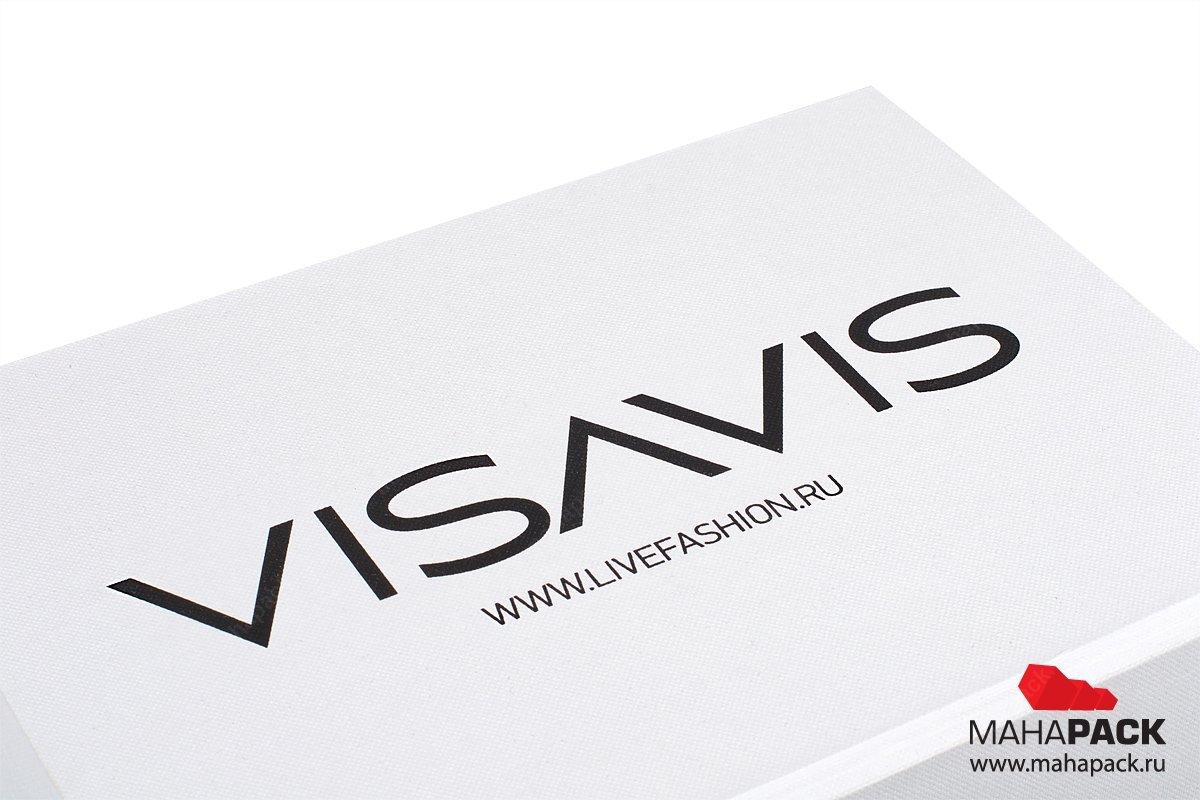 подарочные упаковки с логотипом, выполненный тиснением серебряной фольгой